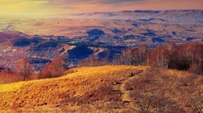 Kislovodsk, Russia. View from a high mountain to the mountains and road. Kislovodsk, Russia. View from a high mountain to the mountains and forest royalty free stock image