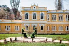 Kislovodsk, Stavropolsky Region, Russia - April 10, 2018 : green sculptures in the form of the women drinking tea on the royalty free stock photography