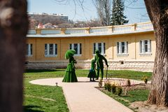 Kislovodsk, Stavropolsky Region, Russia - April 10, 2018: green sculptures of woman, man and a child on background of Narzan royalty free stock photo