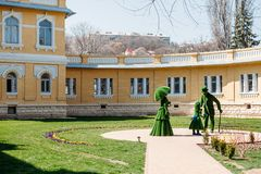 Kislovodsk, Stavropolsky Region, Russia - April 10, 2018: green sculptures of woman, man and a child on background of Narzan stock photo