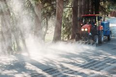 Kislovodsk, Stavropolsky Region, Russia - April 10, 2018: Tractor cleans asphalt road in Kislovodsk National Park stock photos
