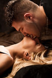 Kiss. Young passion lovers kissing, studio shot Stock Images
