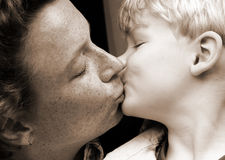 Kiss. Mother and son Stock Photos