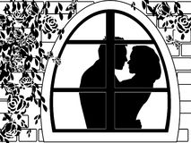 Kiss. Silhouette of a kissing couple in the window Royalty Free Stock Images