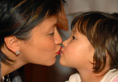 Kiss. Mom and daughter are kissing Stock Images