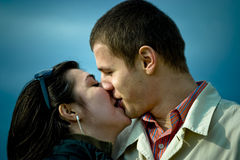 Kiss. A young Caucasian couple share an intimate kiss Royalty Free Stock Photography