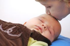 Kiss. Child kissing her little brother Stock Photography