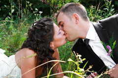 Kiss. Happy married couple kissing in a natural environment stock photo