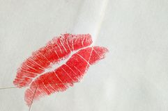 Kiss. Close up of white envelope and red lipstick on it Royalty Free Stock Photography