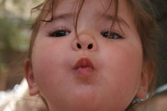 Kiss. Toddler making kissy face. child is 1/2 japanese and 1/2 caucasian stock image