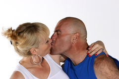 The kiss. Mature man and woman in sportswear kissing Stock Photography
