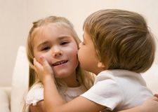 Kiss. Little boy kiss his sister Royalty Free Stock Images