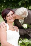 Kiss. Man is kissing his bride Stock Photography