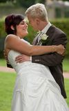 Kiss. Man is kissing his bride Royalty Free Stock Image