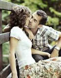 Kiss. Young couple kissing in the nature - side view stock images