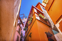 Kiss Alley Colored Houses Guanajuato Mexico. Kiss Alley Alleyway Colored Houses Guanajuato Mexico.  Houses so close couple can exchange a kiss between balconies Royalty Free Stock Images