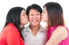 Kiss. Asian senior women kissed by her two daughters Stock Photos
