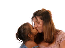 Kiss for Auntie. Young girl giving a kiss to her favorite Aunt Stock Image