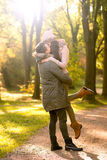 Kiss. In autumn park Royalty Free Stock Photography