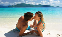 Kiss on a beach Stock Photos