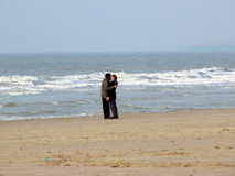 Kiss on the beach. Young couple kissing on the beach Royalty Free Stock Photography