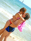 Kiss on the beach. Interesting oriented photo with a couple kissing on the beach Royalty Free Stock Photography