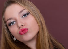 Kiss of a beautiful  woman Stock Photography