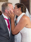 Kiss between beautiful young wedding couple lovers Stock Photography