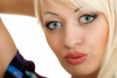 Kiss of beauty blonde. Young blonde woman sands a kiss Stock Photo