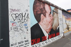 The Kiss, Berlin. Soviet leader Leonid Brezhnev leaning in to kiss his East German counterpart Erich Honecker, a larger-than-life painting by russian artist Royalty Free Stock Images