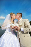 Kiss the bride and groom. With the pigeons in the hands Stock Photo