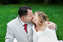 Kiss bride and groom. Romantic kiss bride and groom on wedding walk Royalty Free Stock Photo
