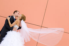 Kiss of bride and groom stock images