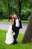 Kiss bride and groom. On wedding walk Royalty Free Stock Photos