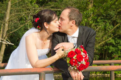 Kiss of bride and groom after Stock Image