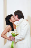 Kiss bride and groom Stock Photography