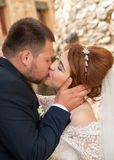 Kiss of the bride and groom. Wedding shot in the old town.  Warm Stock Photo