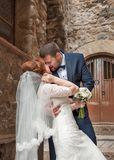 Kiss of the bride and groom. Wedding shot in the old town.  Warm. Embraces and gentle touches Royalty Free Stock Images