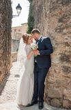 Kiss of the bride and groom. Wedding shot in the old town.  Warm Stock Photography
