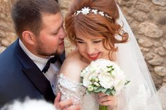 Kiss of the bride and groom. Wedding shot in the old town.  Warm Stock Image