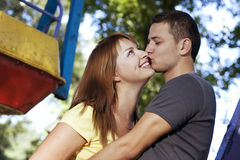 Kiss on the carousel Stock Photography