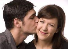 Kiss on the cheek royalty free stock photo