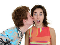 Kiss On the Cheek. Couple on white Royalty Free Stock Photography