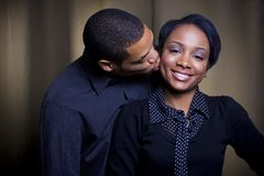 A kiss on the cheek royalty free stock images