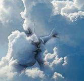 Kiss in the clouds royalty free stock photography