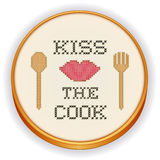 Kiss the Cook Cross Stitch Embroidery on Wood Hoop Stock Photo