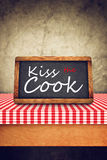 Kiss The Cook Title on Restaurant Slate Chalkboard Stock Photo