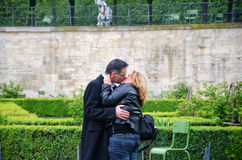 The Kiss. Couple kissing in the gardens of the Louvre Stock Photos