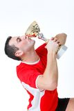 Kiss the cup. Happy man kissing cup. Side view Royalty Free Stock Photo