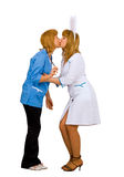 A kiss between a doctor and a nurse Royalty Free Stock Image